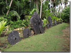 A line-up of stone money at the bank, Yap, Micronesia