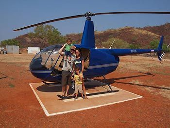 Family Hochgrebe ready to board the helicopter, which will take them across Purnululu National Park to see the Bngle Bungle Range. Western Australia