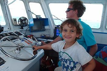 Max steering the boat on our way back to shore. Jurien Bay, Western Australia
