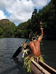 Paddling up McLaren Sound in an outrigger, Oro, Papua New Guinea