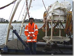 This    is me, next to the diving bell (used for surface supply diving) on Big Pearl.  'High viz' clothing, steel capped boots and hard hats were the order    of the day.