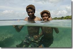 An over-under shot of some children in Vanuatu