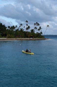 Max kayaking with one of the nannies at Wakatobi.